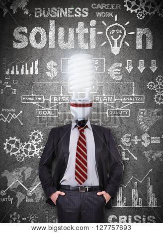 Businessman With Head Energy Saving Bulb