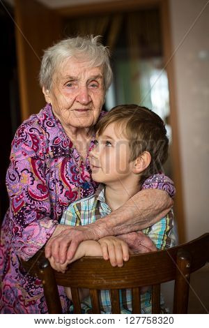 An elderly woman with his young grandson.
