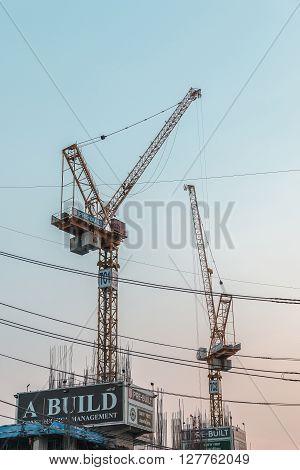 BANGKOK THAILAND - APRIL 28 2016 : A BUIL Working construction crane in Bangkok