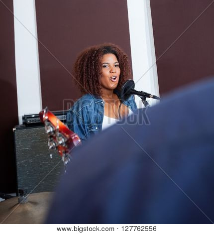 Female Singer Performing In Recording Studio
