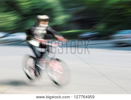 Boy Cyclist In Traffic On The City Roadway
