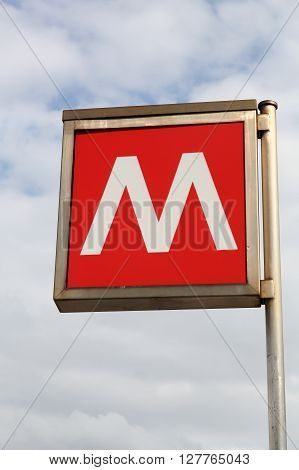 Milan, Italy - April 15, 2016: Red metro sign in Milan, Italy.