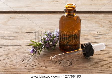 close-up of essence of rosemary on wooden table