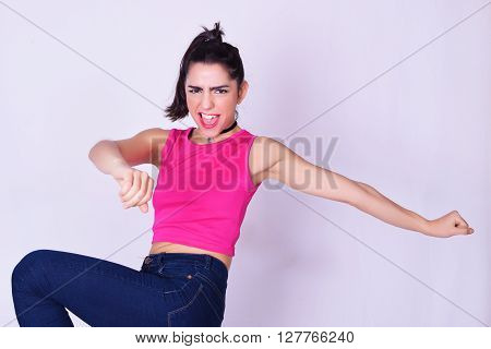 Portrait of fashionable young woman wearing stylish urban clothes. Fashion studio portrait over grey backgroung. ** Note: Soft Focus at 100%, best at smaller sizes