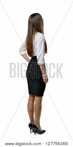 Back view of cutout businesswoman holding her hand on waist. Success and development. Business staff. Office clothes. Dress code. Presentable appearance. Beauty and youth. Back view pose.