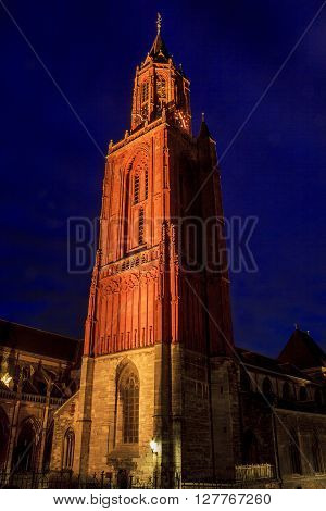 Maastricht, Netherlands - May 15: It is a night view of the illuminated red bell tower of St. Nicholas Church May 15, 2013 in Maastricht, Netherlands.