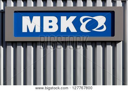 Villefranche, France - March 27, 2016: MBK logo on a wall. MBK a subsidiary of Yamaha Motor Company, is a french scooter manufacturer, based in Rouvroy, France.