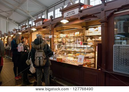 HELSINKI, FINLAND - APRIL 23, 2016: People near the counter in The Old Market Hall (Wanha Kauppahalli). Was built in 1888. It was the first indoor hall in Helsinki. Located near Market Square