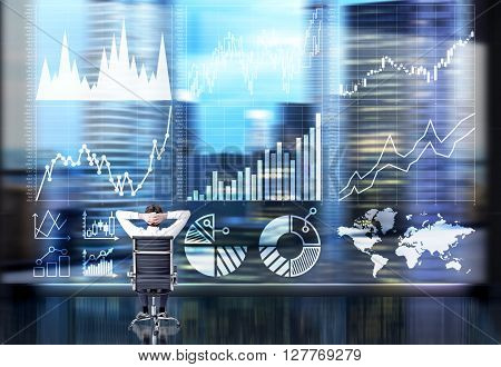 Businessperson with hands on head sitting in front of business chart and cityscape. Double exposure