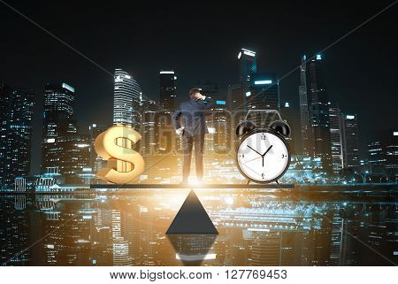 Business concept time is money. Businessman on scale making decisions between money and clock with night time Singapore city in the background