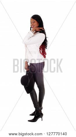A beautiful African American woman in black leather tights and white jacket standing in profile isolated for white background.