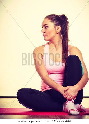 Gymnastic Girl Sitting On Matress.