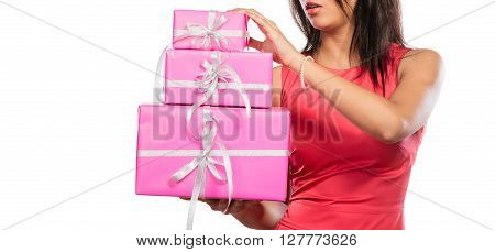 Close up of human with pink rose boxes gifts isolated on white. Christmas xmas winter time season concept.