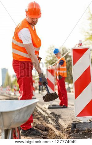 Labourer In Orange Safety Helmet