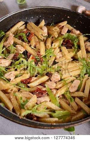 Penne Pasta With Chicken, Dried Tomatoes And Ruckola