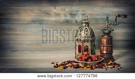 Golden lantern and antique mill. Oriental arabic decoration. Vintage style toned picture