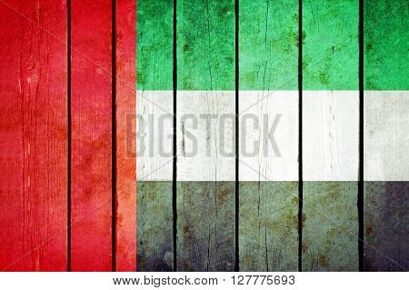 United arab emirates wooden grunge flag. United arab emirates flag painted on the old wooden planks. Vintage retro picture from my collection of flags.