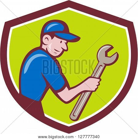Illustration of a repairman handyman worker wearing hat carrying spanner wrench looking to the side set inside shield crest done in cartoon style.
