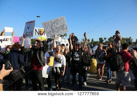 Costa Mesa, CA - April 28, 2016: Protesters hold signs, chant and attempt to disrupt supporters of republican presidential candidate Donald Trump, at a rally at the Costa Mesa CA.