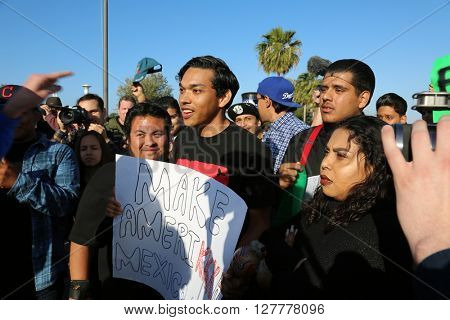 Costa Mesa, CA - April 28, 2016: Protesters of republican presidential candidate Donald Trump, hold Signs, Chant and attempt to disrupt supporters of Donald j. Trump  at a rally at the Costa Mesa CA.