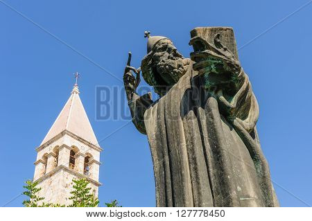Monumental bronze statue of Bishop Gregory of Nin created in 1929 by Ivan Mestrovic and Saint Rainier Benedict monastery belfry