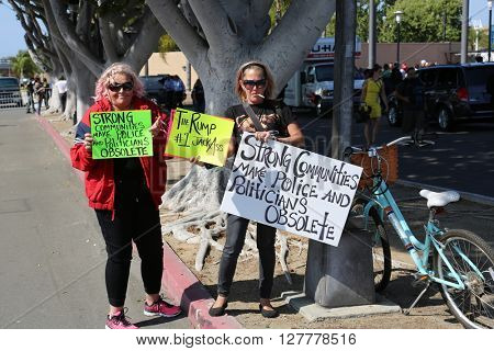 Costa Mesa, CA - April 28, 2016: Protesters of republican presidential candidate Donald Trump, at a rally at the Costa Mesa CA.