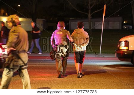 Costa Mesa, CA - April 28, 2016: Protesters of republican presidential candidate Donald Trump, Riot in the streets while the police control the crowd and make arrest  at a rally at the Costa Mesa CA.