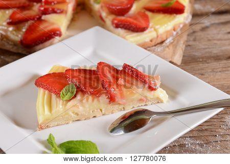 Homemade strawberry tart with cream and fresh straberries