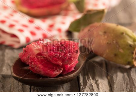 slices of prickly pear cactus on wooden spoon