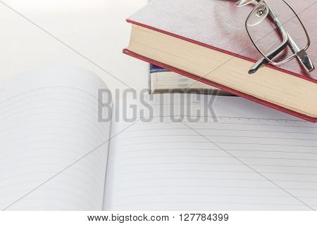 Eyeglasses And Notepad With Blank Page