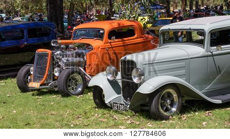 PERTH, AUSTRALIA - FEBRUARY 13, 2016: Brightly colored hot rods on display at an open-air exhibition in Perry Lakes in Perth, Western Australia.