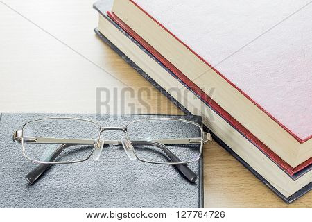 Glasses Put On Notebook