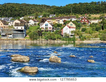 The Rhine river in Switzerland, somewhat above the Rhine Falls waterfall.