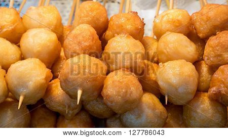 The close up of Taiwanese fried fish balls on stick at food street market in Taipei, Taiwan.
