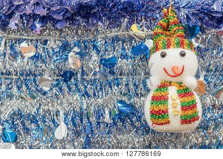 Snowman and tinsel for the holiday background