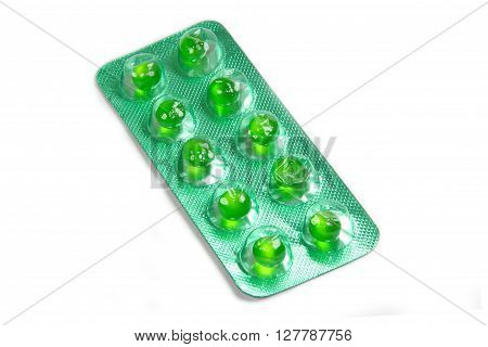Closed up flatulence green pill in the blister pack