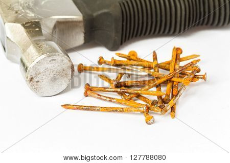 Hammer with rusted nails isolated on white background
