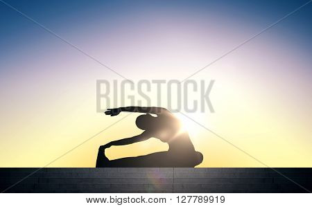 fitness, sport, training and lifestyle concept - woman exercising and stretching on stairs over sun light background
