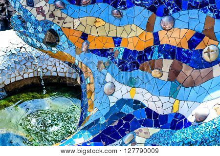 BARCELONA, SPAIN-MARCH 24, 2014: Blue Mosaic Dragon-Fountain designed by Antonio Gaudi in the famous summer Park Guell, Barcelona, Catalonia, Spain