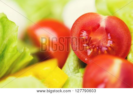diet, vegetable food, healthy eating and objects concept - close up of ripe cut vegetables in salad