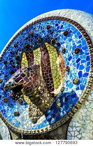 BARCELONA, SPAIN-MARCH 24, 2014: Blue Mosaic Dog-Fountain designed by Antonio Gaudi in the famous summer Park Guell, Barcelona, Catalonia, Spain