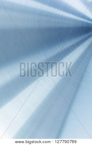 The bright polished metal surface. The background.