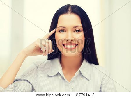 business, education and technology concept - smiling woman pointing to imaginary glasses