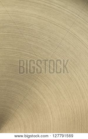 The golden polished metal surface. The background. ** Note: Shallow depth of field