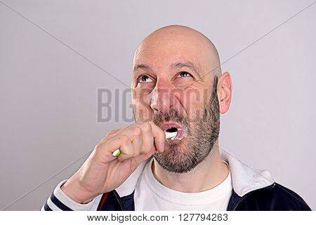 Bald Headed Man Brushing Teeth