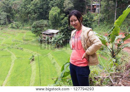 Thai woman with Terraced Rice Field, Pha Mon Chiangmai Thailand