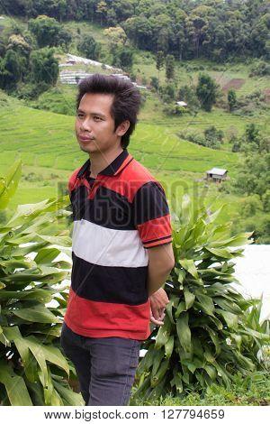 Thai man with Terraced Rice Field, Pha Mon Chiangmai Thailand