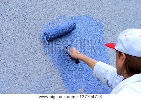 Workman Painting The Wall