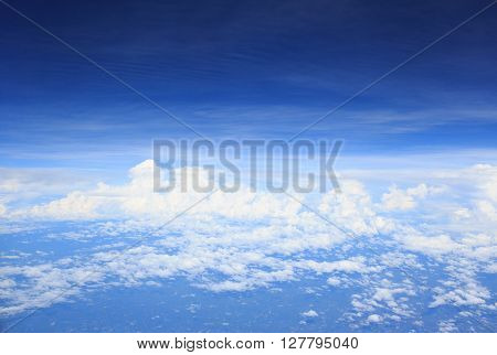 clear white cumulus cloud and cloudscape on blue sky horizon background view from aircraft plane