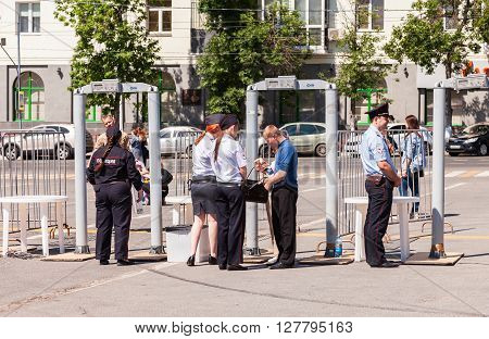 SAMARA RUSSIA - JUNE 12 2015: Fence with police frames metal detectors at the central square in summer day